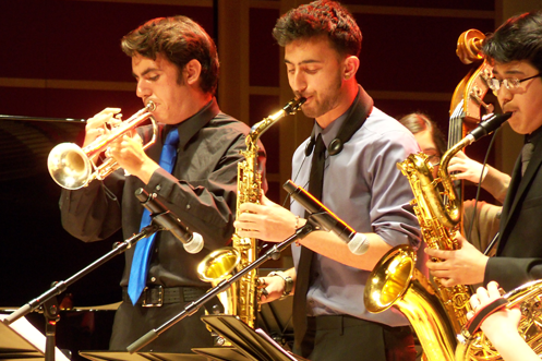 Brass players standing to play