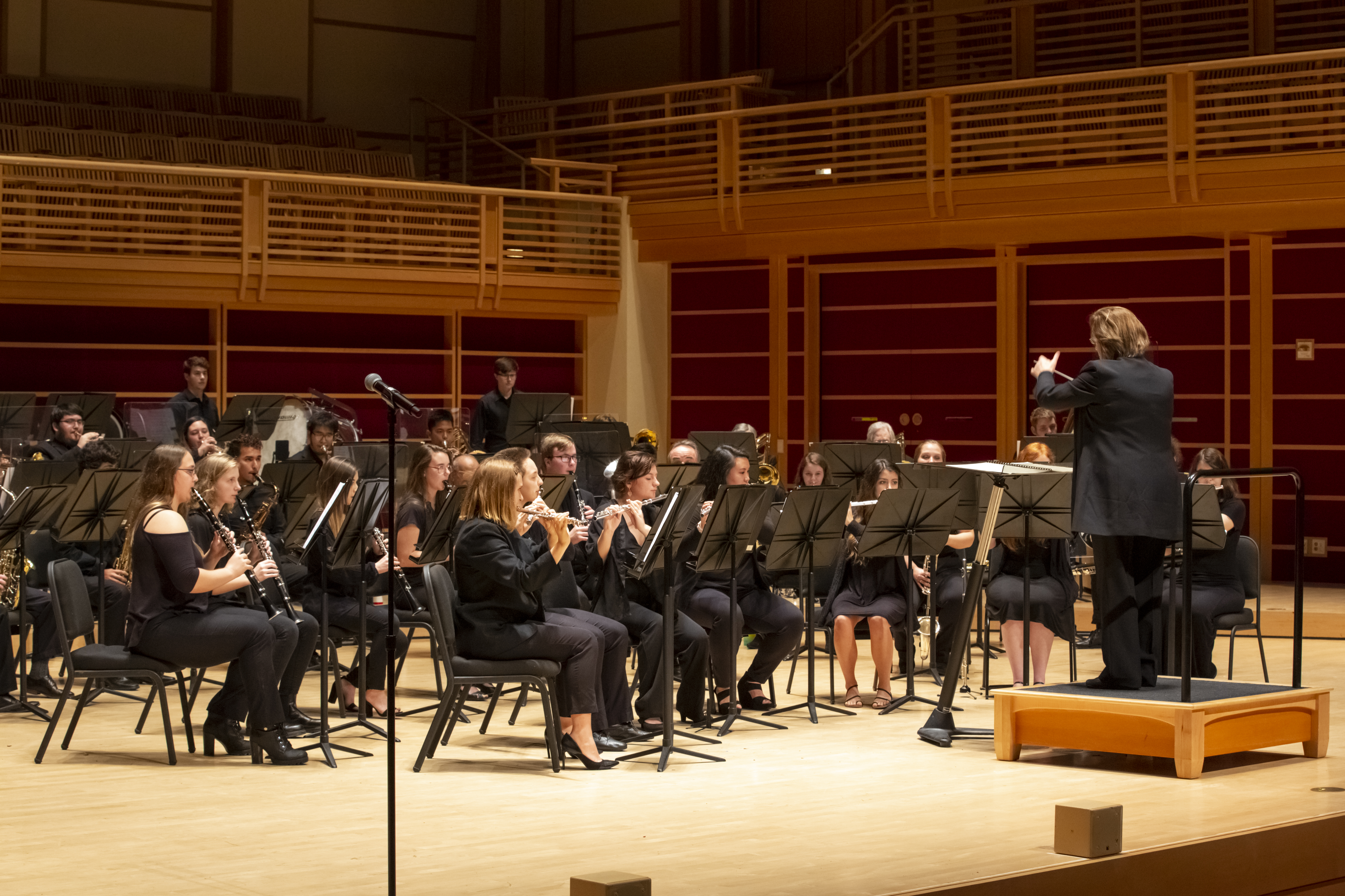 Dr. Mieder conducting the concert band on weill hall stage