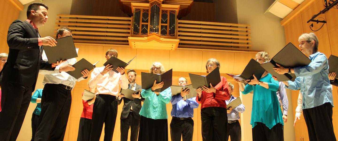 a photograph of a group of vocal performers on the Schroeder Hall stage in the Green Music Center