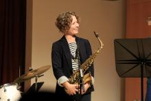 Kasey Knudsen on stage with saxophone