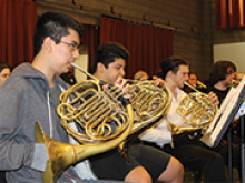 The French horn section of the orchestra rehearses at Sonoma State University