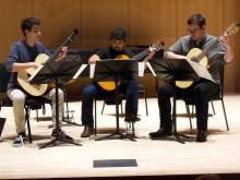 three classical guitarists