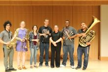 Shown are 6 winds musicians and, Dr. Kim Mieder, who directs the community group.