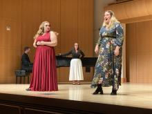 Three opera performers and a pianist onstage