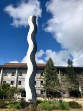 This is a photograph of a statue in the central Sonoma State University campus