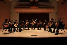 Guitar ensemble playing on Schroeder Hall stage