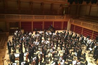 Aerial view of the orchestra standing on stage