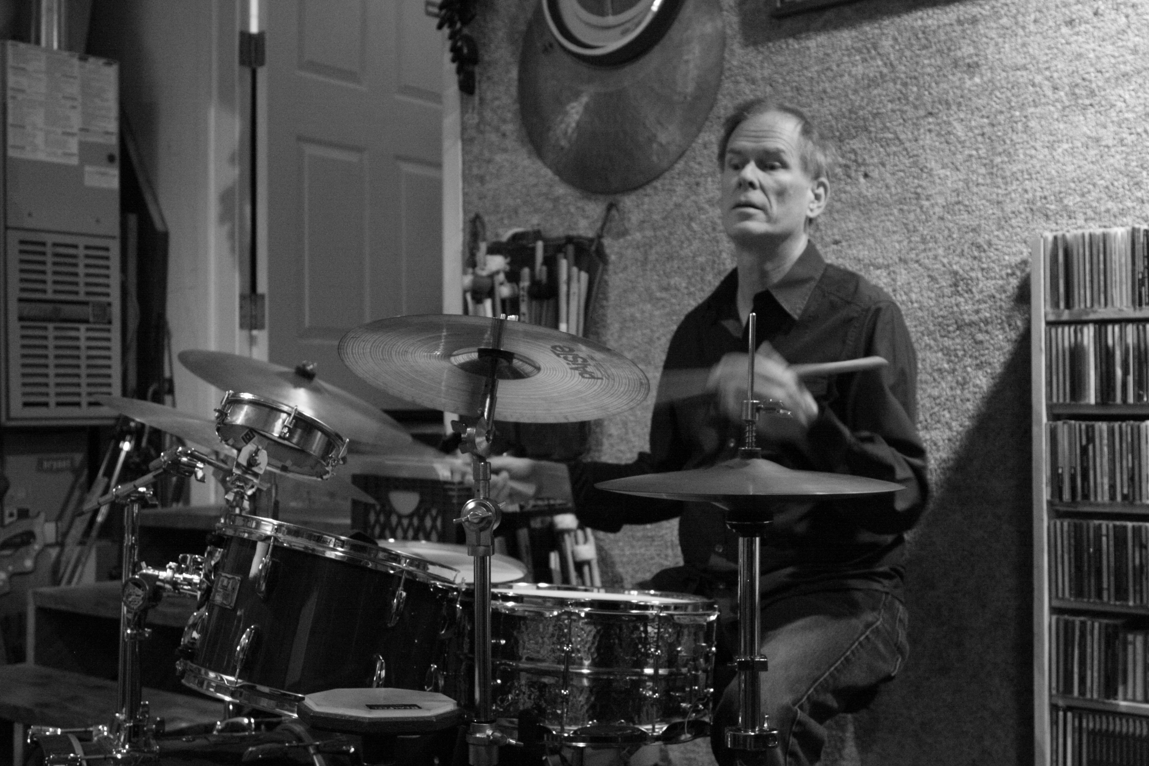 Kendrick Freeman playing drums in black and white