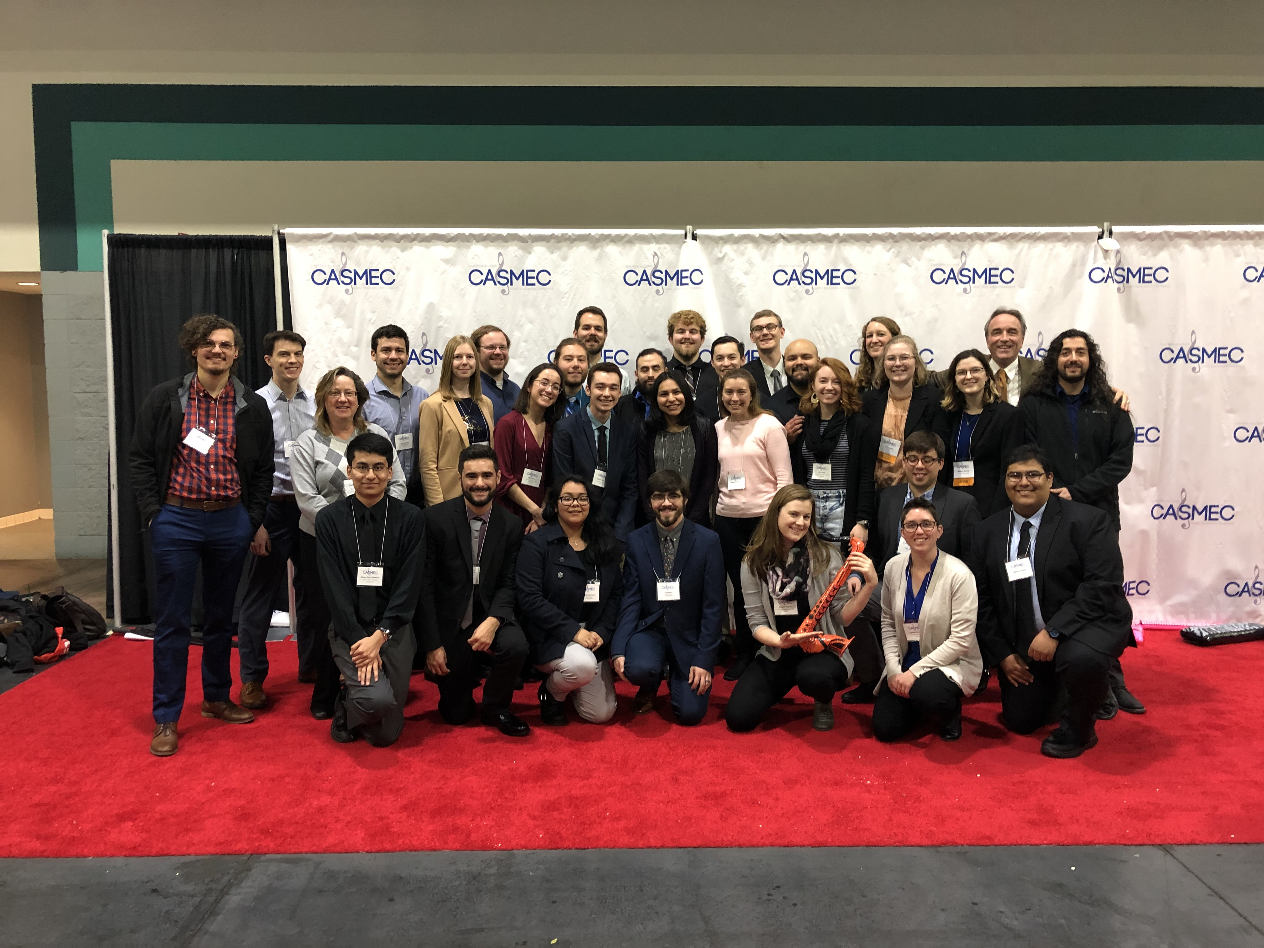 Group Picture of students in front of banner at CASMEC