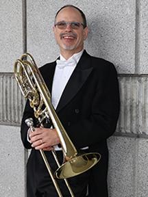 David Ridge holding a trombone