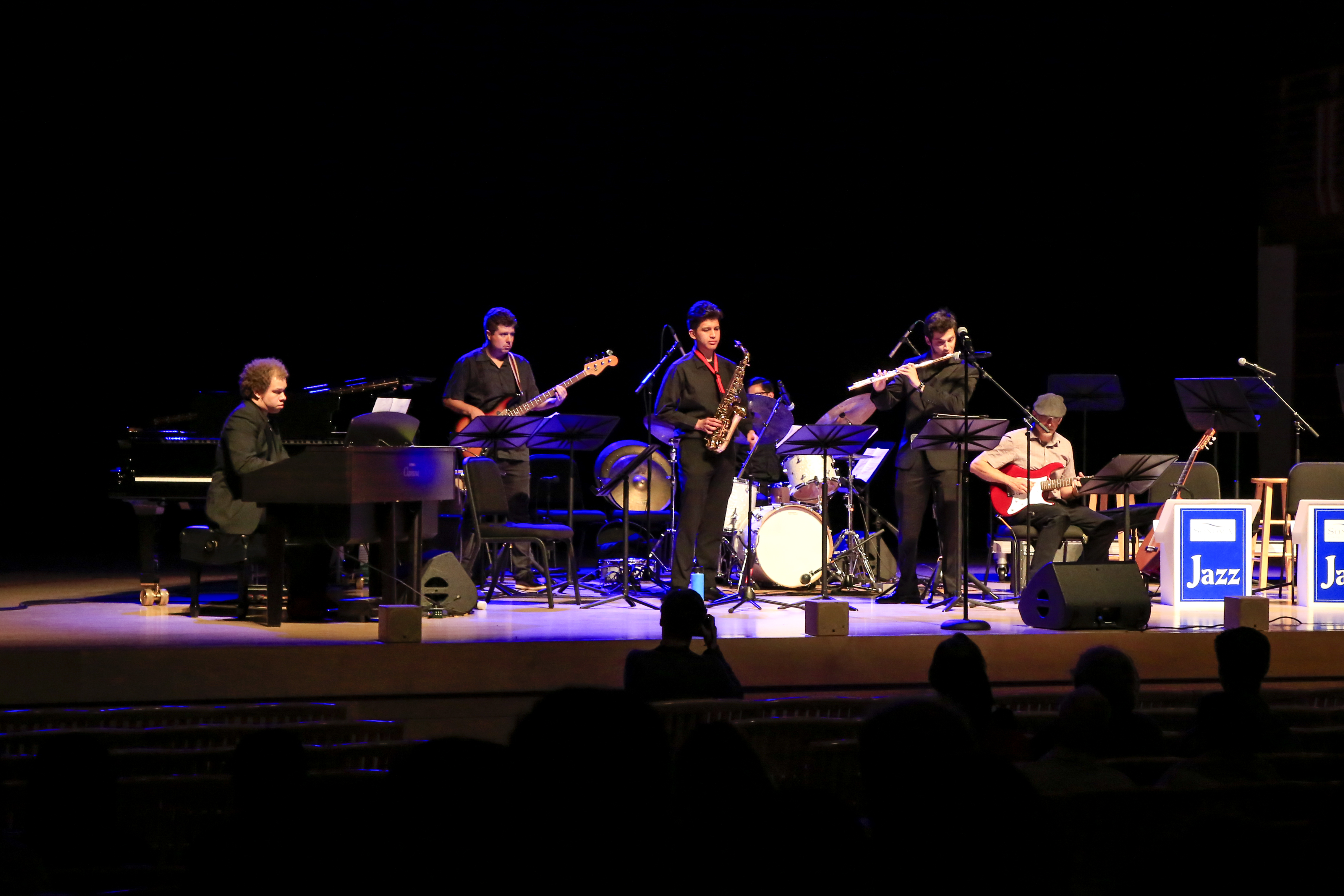 Latin Band performing on stage in Weill Hall