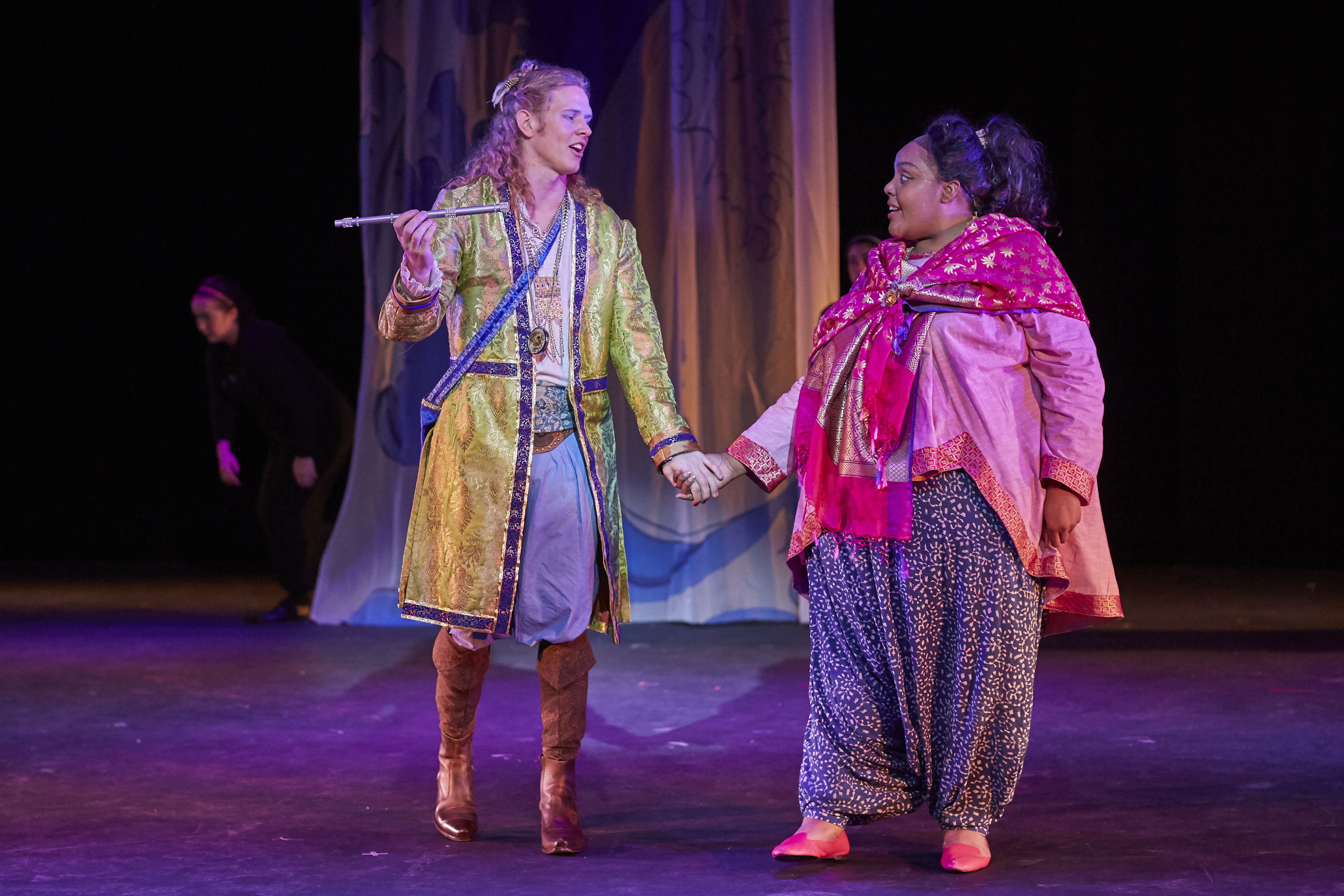 Actors holding hands from the Magic Flute