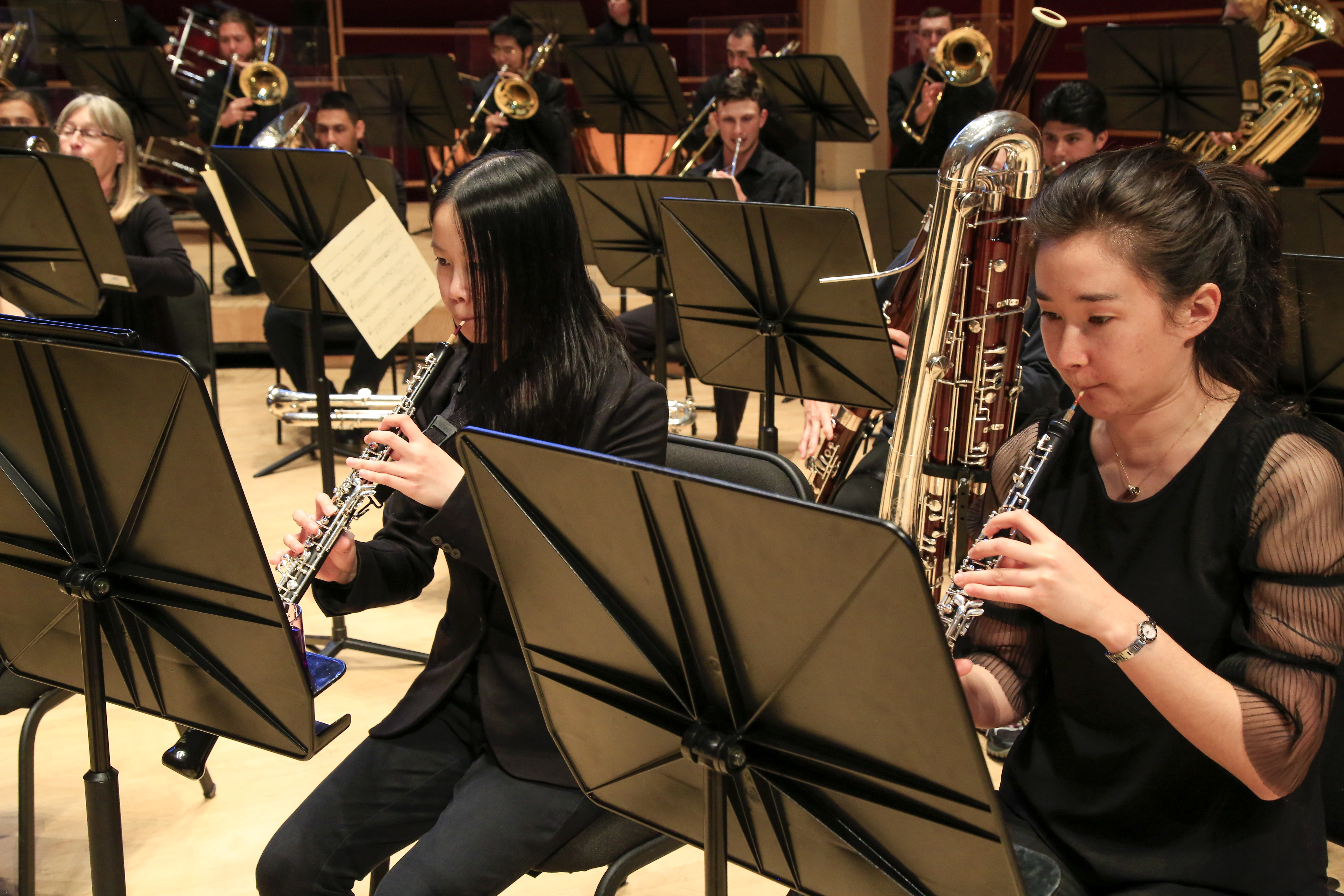 Close up on two wind instrumentalists in the wind ensemble