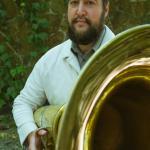 Jonathan Seiberlich Headshot holding a tuba