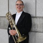 David Ridge Headshot holding trombone