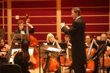 Alex Kahn conducting the Orchestra