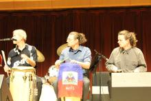 Three drummers playing Haitian drums play in the SSU Jazz Ensemble year end performance.