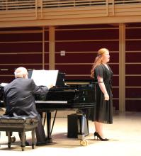 Singer on stage with pianist