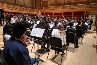 Side view of the orchestra in rehearsal